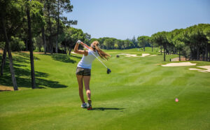 Girl golfing in the Algarve